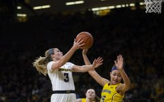 Iowa guard Makenzie Meyer attempts a layup during the Iowa/Michigan women's basketball game at Carver-Hawkeye Arena on Thursday, January 17, 2019. The Hawkeyes defeated the Wolverines, 75-61.