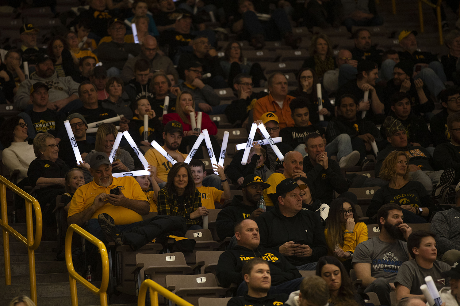 Iowa+fans+hold+glow+sticks+to+spell+%22IOWA%22+during+the+Iowa%2FRutgers+wrestling+meet+at+Carver-Hawkeye+Arena+on+Friday%2C+January+18%2C+2019.+The+Hawkeyes+defeated+the+Scarlet+Knights%2C+30-6.+