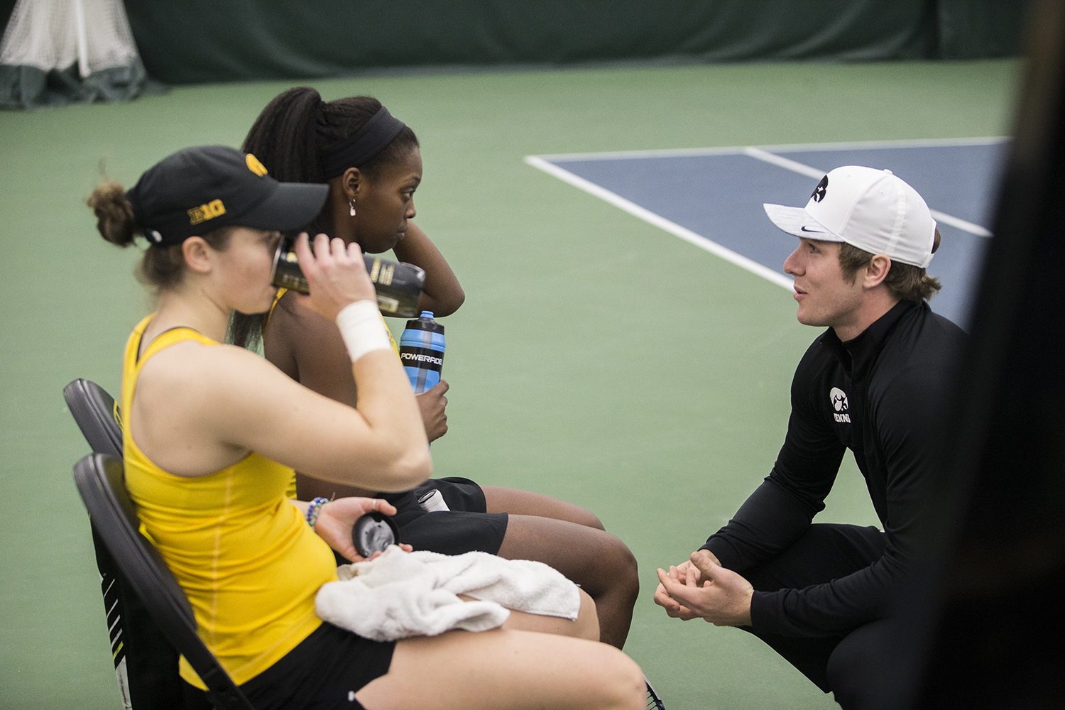 Iowa%27s+coach+Daniel+Leitner+coaches+doubles+team+Adorable+Huckleby+and+Elise+Van+Huevelen+during+a+tennis+match+between+Iowa+and+Xavier+at+the+Hawkeye+Tennis+and+Recreation+Complex+on+Friday%2C+January+18%2C+2019.+The+Hawkeyes+swept+the+match+against+the+Musketeers%2C+7-0.