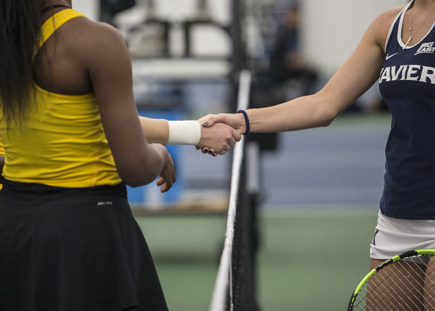 Players+shake+hands+after+a+tennis+match+between+Iowa+and+Xavier+at+the+Hawkeye+Tennis+and+Recreation+Complex+on+Friday%2C+January+18%2C+2019.+The+Hawkeyes+swept+the+match+against+the+Musketeers%2C+7-0.