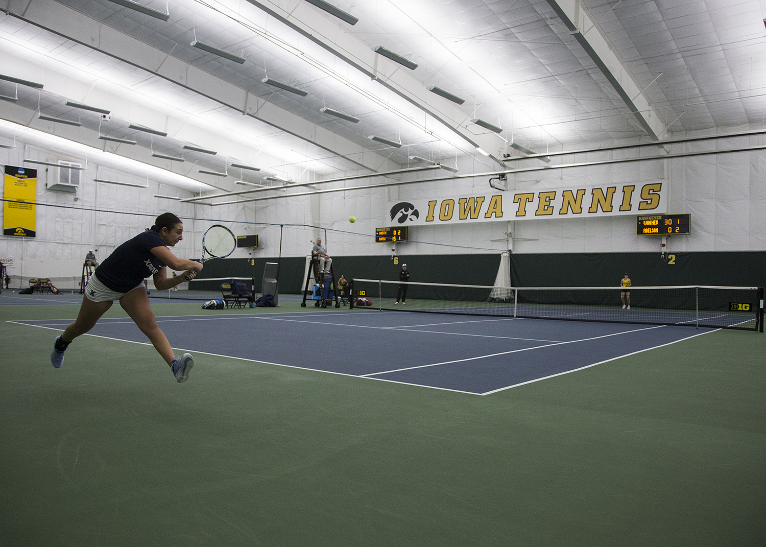 Xavier%27s+Sophie+Abelson+returns+a+serve+during+a+tennis+match+between+Iowa+and+Xavier+at+the+Hawkeye+Tennis+and+Recreation+Complex+on+Friday%2C+January+18%2C+2019.+The+Hawkeyes+swept+the+match+against+the+Musketeers%2C+7-0.
