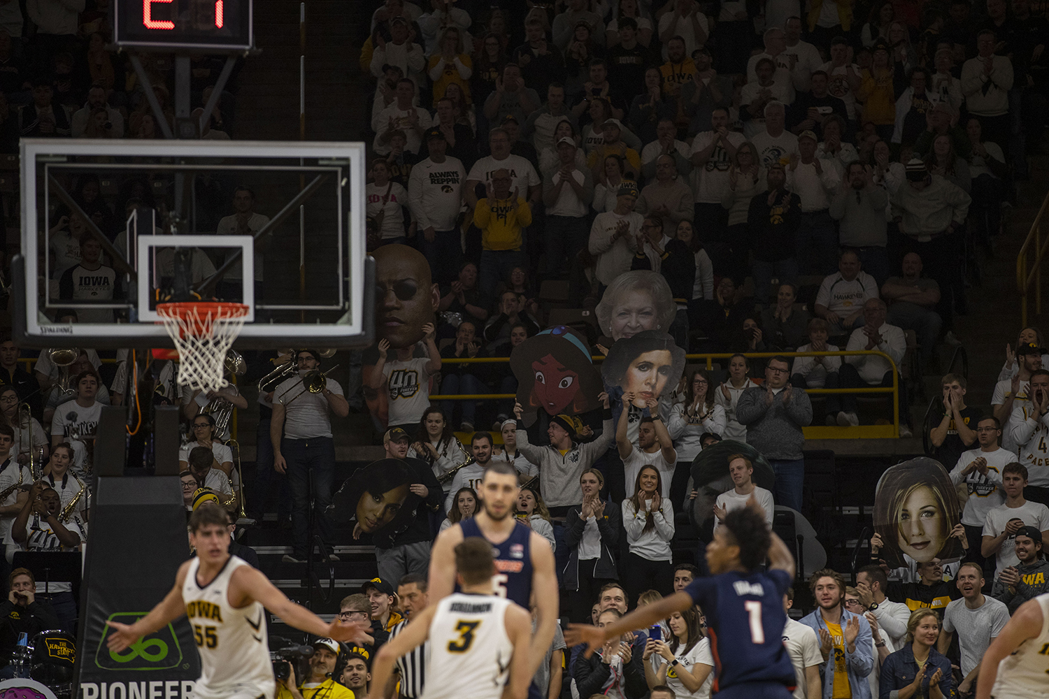 The+Iowa+student+section+holds+up+signs+during+the+Iowa%2FIllinois+men%27s+basketball+game+at+Carver-Hawkeye+Arena+on+Sunday%2C+January+20%2C+2019.+The+Hawkeyes+defeated+the+Fighting+Illini%2C+95-71.+