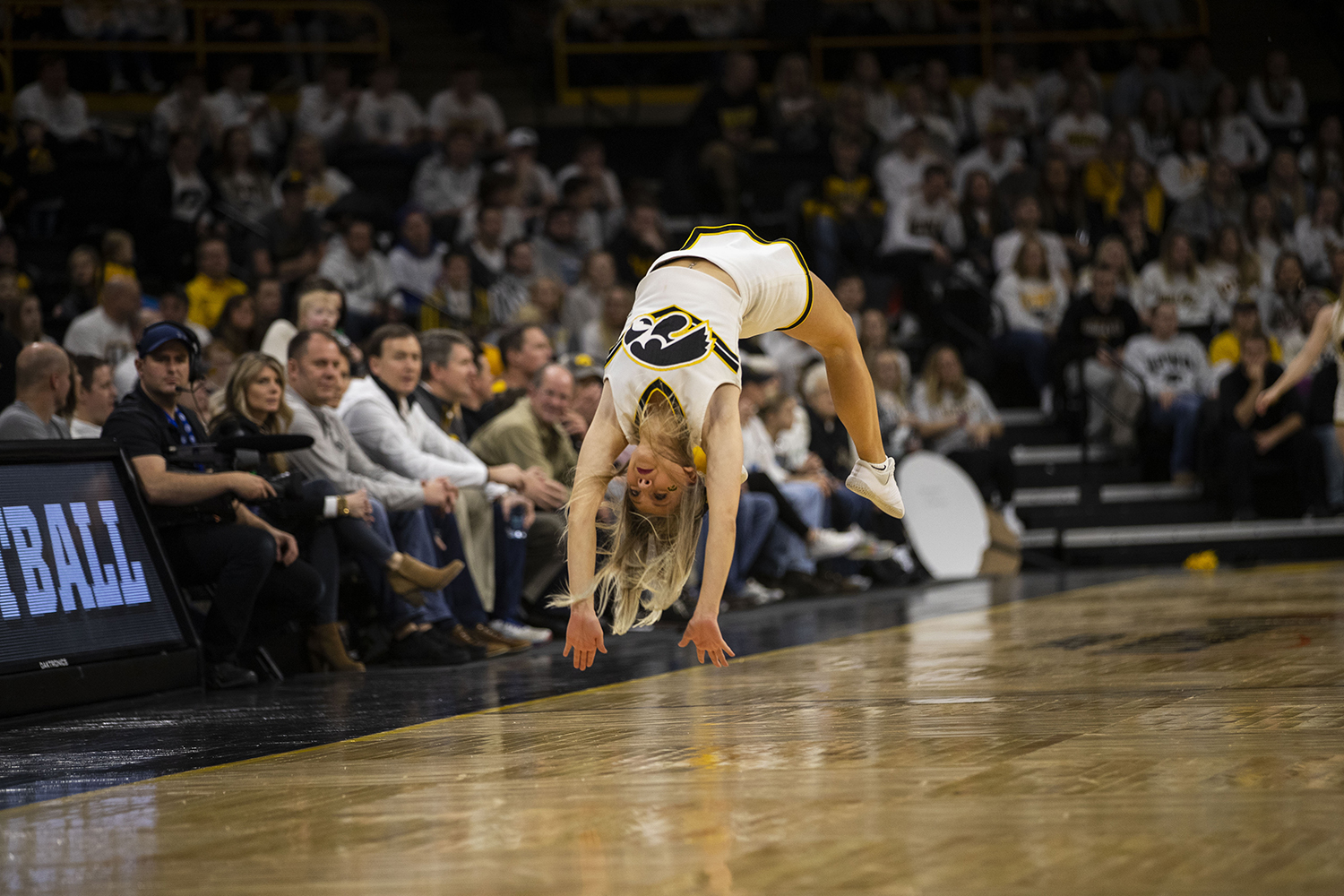 An+Iowa+Spirit+Squad+member+does+a+back+handspring+during+the+Iowa%2FIllinois+men%27s+basketball+game+at+Carver-Hawkeye+Arena+on+Sunday%2C+January+20%2C+2019.+The+Hawkeyes+defeated+the+Fighting+Illini%2C+95-71.+