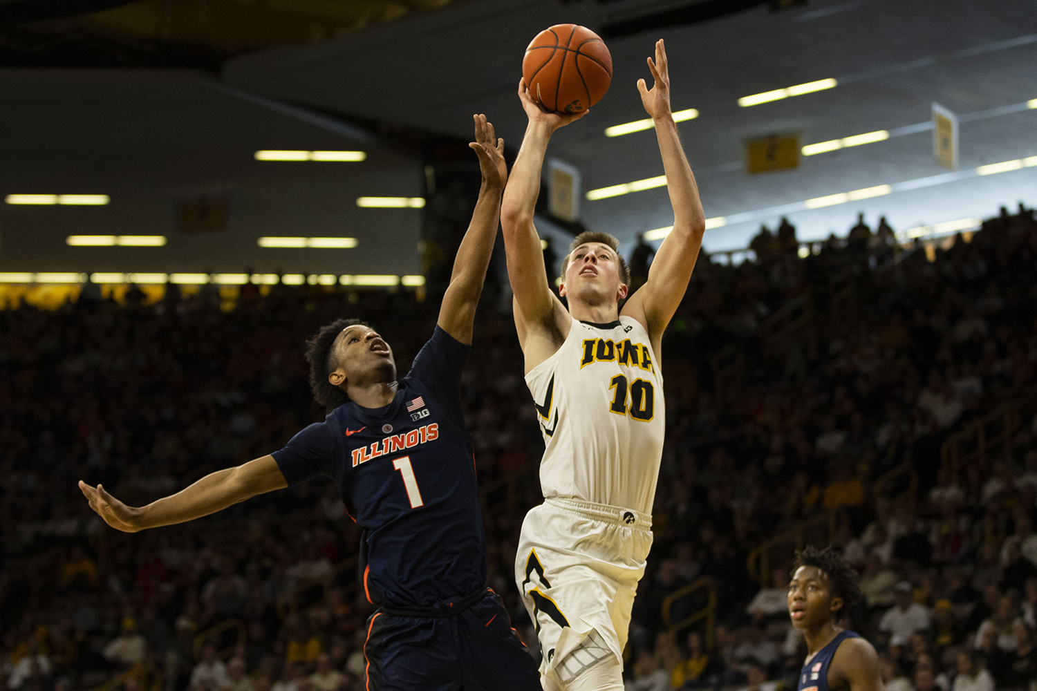 Iowa+guard+Joe+Wieskamp+attempts+a+shot+during+the+Iowa%2FIllinois+men%27s+basketball+game+at+Carver-Hawkeye+Arena+on+Sunday%2C+January+20%2C+2019.+The+Hawkeyes+defeated+the+Fighting+Illini%2C+95-71.+