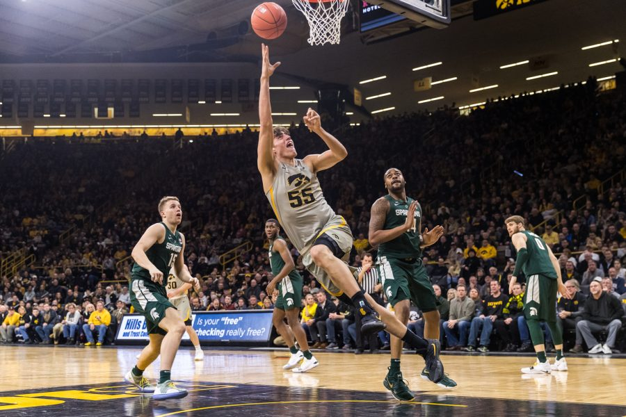 Iowa+forward+Luka+Garza+%2355+throws+up+a+shot+during+a+basketball+game+against+Michigan+State+on+Thursday%2C+Jan.+24%2C+2019.+The+Spartans+defeated+the+Hawkeyes+82-67.+%28David+Harmantas%2FThe+Daily+Iowan%29