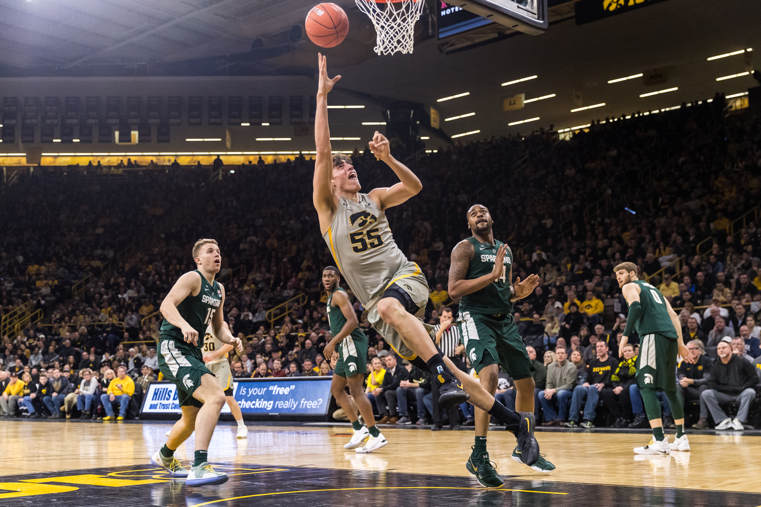 Iowa forward Luka Garza #55 throws up a shot during a basketball game against Michigan State on Thursday, Jan. 24, 2019. The Spartans defeated the Hawkeyes 82-67. (David Harmantas/The Daily Iowan)