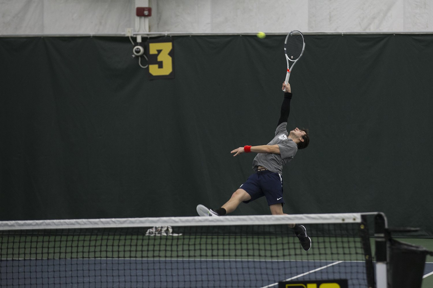 Butler%27s+Mason+Dragos+reaches+back+to+return+a+ball+at+a+tennis+match+between+East+Tennessee+State+and+Butler.+The+Buccaneers+won+the+match+7-0.