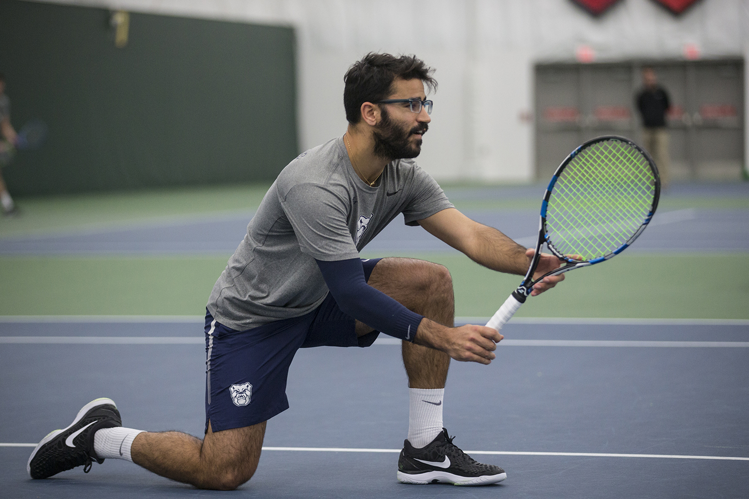 Butler%27s+Aviv+Ben+Shabat+kneels+out+of+the+way+of+his+teammate%27s+serve+at+a+tennis+match+between+East+Tennessee+State+and+Butler.+The+Buccaneers+won+the+match+7-0.