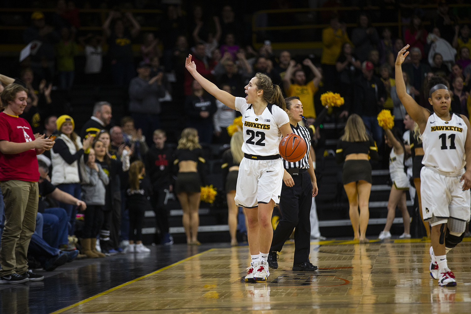 Iowa guard Kathleen Doyle gestures at the crowd to get loud during the Iowa/Purdue women's basketball game at Carver-Hawkeye Arena on Sunday, January 27, 2019. The Hawkeyes defeated the Boilermakers, 72-58. (Lily Smith/The Daily Iowan)