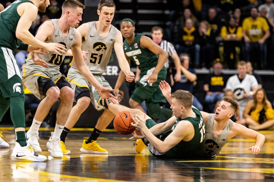 Players+battle+for+the+ball+during+a+basketball+game+between+Iowa+and+Michigan+State+at+Carver-Hawkeye+Arena+on+Thursday%2C+Jan.+24%2C+2019.+The+Spartans+defeated+the+Hawkeyes+82-67.+