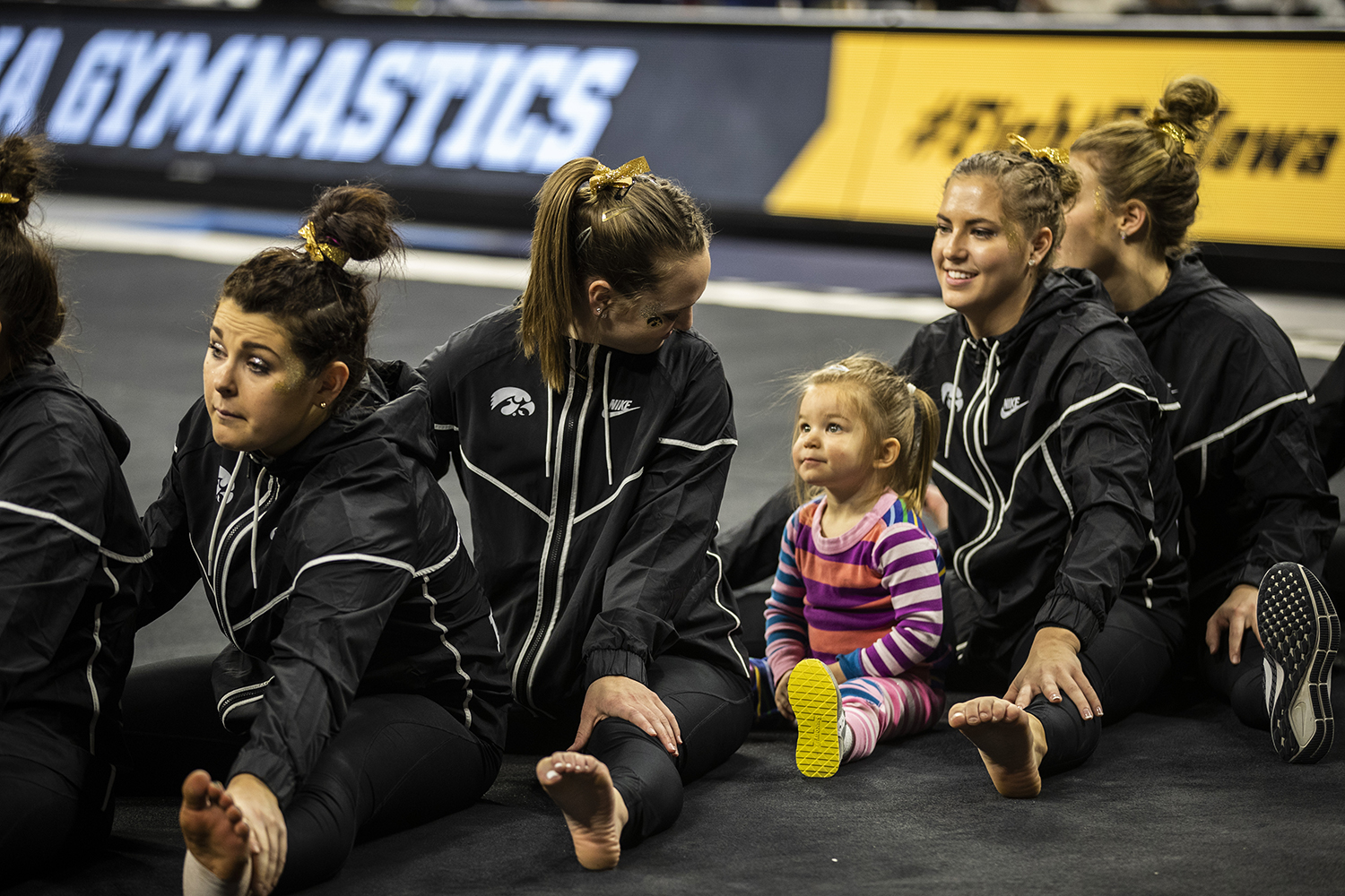 A+young+fan+joins+Iowa+gymnasts+for+the+awards+ceremony+during+the+women%27s+gymnastics+meet+vs.+SEMO+at+Carver-Hawkeye+Arena+on+Friday%2C+January+11%2C+2019.+The+GymHawks+defeated+the+Redhawks+194.700-180.925.+