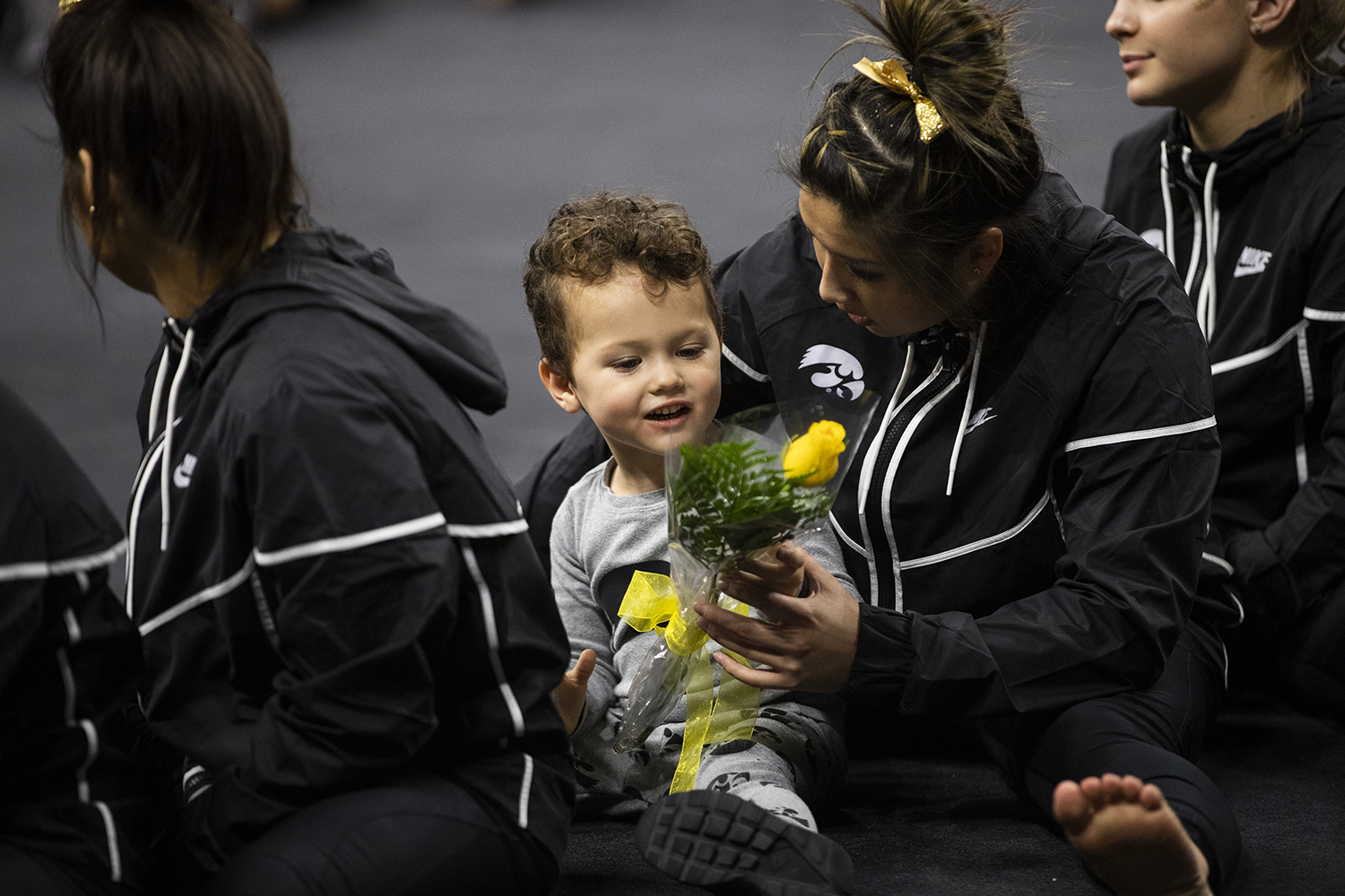 A+young+fan+looks+at+a+flower+with+Iowa+gymnast+Nicole+Chow+during+the+women%27s+gymnastics+meet+vs.+SEMO+at+Carver-Hawkeye+Arena+on+Friday%2C+January+11%2C+2019.+The+GymHawks+defeated+the+Redhawks+194.700-180.925.+