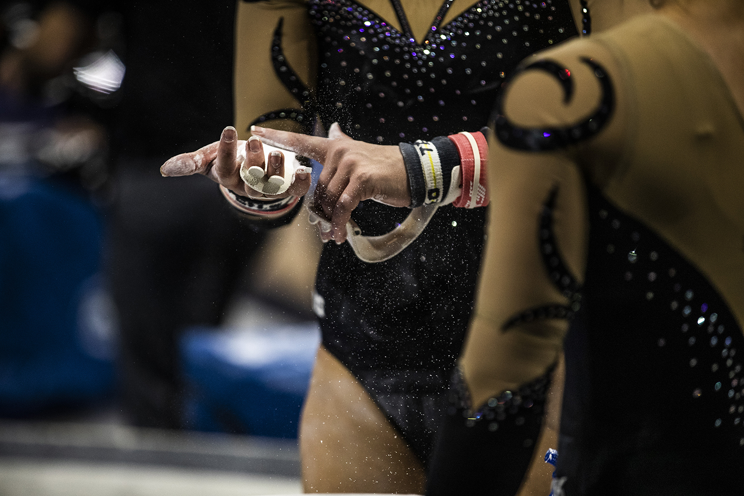 Gymnasts+rub+chalk+on+their+hands+during+the+women%27s+gymnastics+meet+vs.+SEMO+at+Carver-Hawkeye+Arena+on+Friday%2C+January+11%2C+2019.+The+GymHawks+defeated+the+Redhawks+194.700-180.925.+