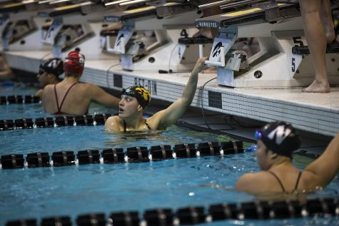 Iowa swimmer Hannah Burvill waits for the results of the race during the Northwestern/Wisconsin swim meet at the Campus Recreation and Wellness Center on Saturday, January 19, 2019. The men's swimming and diving team defeated the Badgers, 164-136, and the Wildcats, 194-106. The women's swimming and diving team fell to the Badgers, 191-109, and the Wildcats, 178-122.