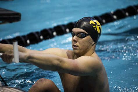 Iowa swimmer Forrest White prepares for his race during the Northwestern/Wisconsin swim meet at the Campus Recreation and Wellness Center on Saturday, January 19, 2019. The men's swimming and diving team defeated the Badgers, 164-136, and the Wildcats, 194-106. The women's swimming and diving team fell to the Badgers, 191-109, and the Wildcats, 178-122.