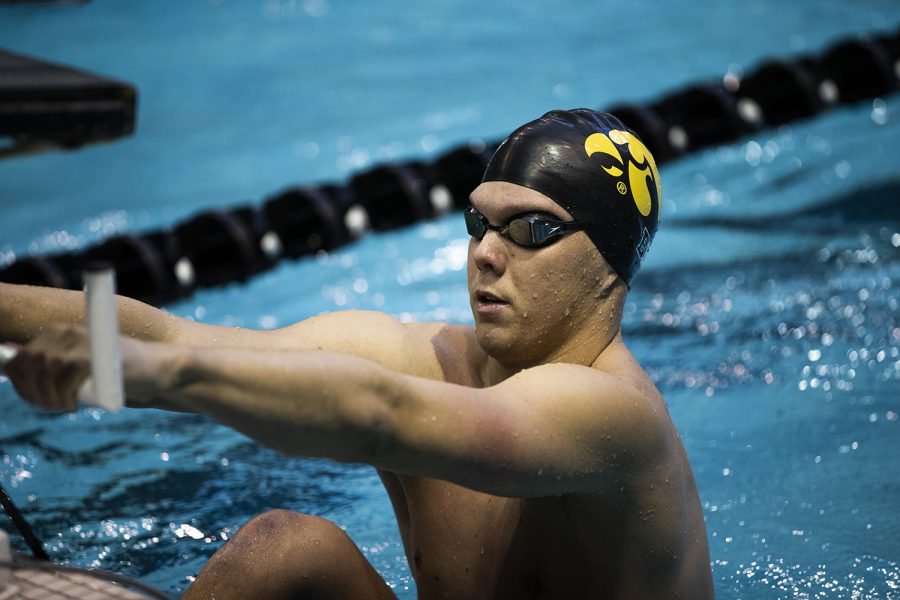 Iowa+swimmer+Forrest+White+prepares+for+his+race+during+the+Northwestern%2FWisconsin+swim+meet+at+the+Campus+Recreation+and+Wellness+Center+on+Saturday%2C+January+19%2C+2019.+The+men%27s+swimming+and+diving+team+defeated+the+Badgers%2C+164-136%2C+and+the+Wildcats%2C+194-106.+The+women%27s+swimming+and+diving+team+fell+to+the+Badgers%2C+191-109%2C+and+the+Wildcats%2C+178-122.+