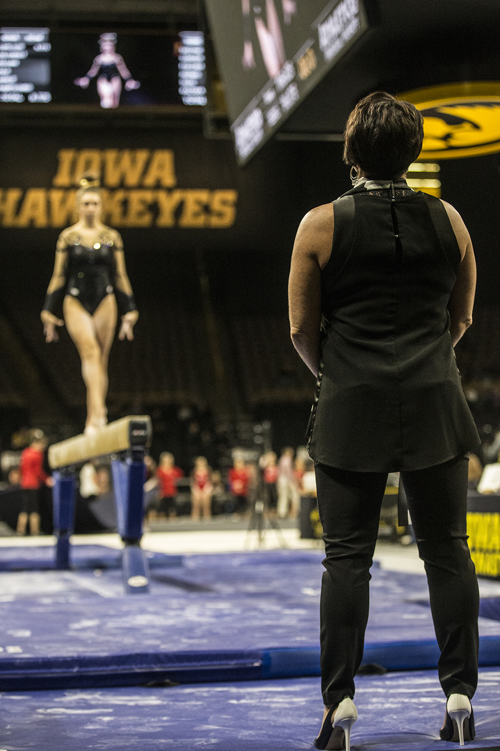 Assistant+coach+Jennifer+Green+watches+Iowa+gymnast+Bridget+Killian+compete+on+the+beam+during+women%27s+gymnastics+vs.+SEMO+at+Carver-Hawkeye+Arena+on+Friday%2C+January+11%2C+2019.+The+GymHawks+defeated+the+Redhawks+194.700-180.925.+