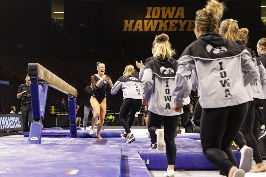 Iowa+Gymnast+Allie+Gilchrist+celebrates+with+her+team+during+a+gymnastics+meet+against+Rutgers+on+Saturday%2C+Jan.+26%2C+2019.+The+Hawkeyes+defeated+the+Scarlet+Knights+194.575+to+191.675.+