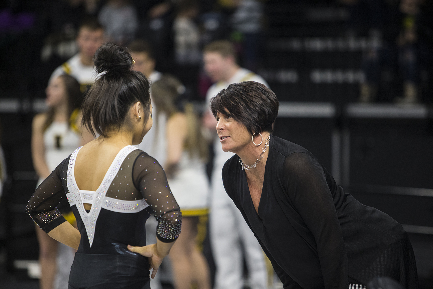 Assistant+coach+Jennifer+Green+talks+to+Iowa+gymnast+Clair+Kaji+at+a+meet+against+Rutgers+on+Saturday%2C+January+26%2C+2019.+The+Hawkeyes+defeated+the+Scarlet+Knights+194.575+to+191.675.+