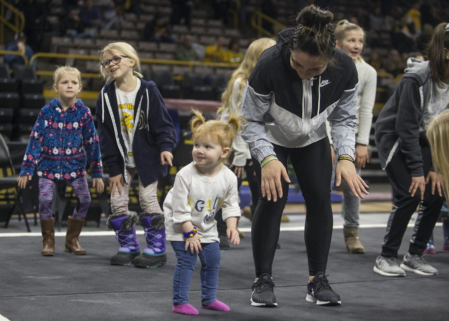 An Iowa gymnast dances with a young fan after a meet against Rutgers on Saturday, January 26, 2019. The Hawkeyes defeated the Scarlet Knights 194.575 to 191.675.