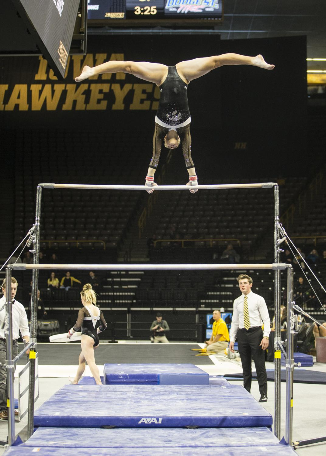 An+Iowa+gymnast+performs+on+the+uneven+bars+during+a+gymnastics+meet+against+Rutgers+on+Saturday%2C+Jan.+26%2C+2019.+The+Hawkeyes+defeated+the+Scarlet+Knights+194.575+to+191.675.+