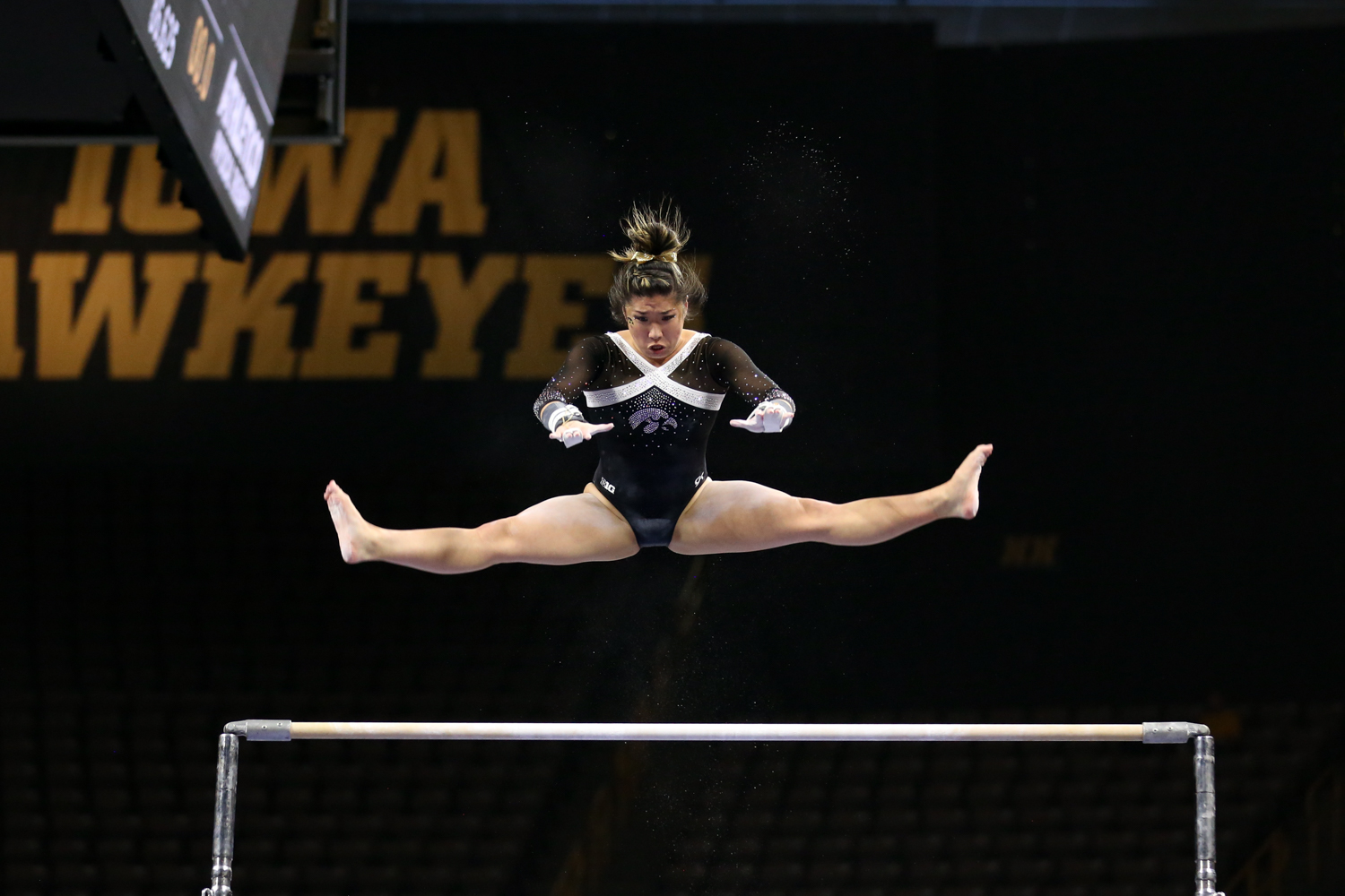 Iowa gymnast Nicole Chow performs on the uneven bars during a gymnastics meet against Rutgers on Saturday, Jan. 26, 2019. The Hawkeyes defeated the Scarlet Knights 194.575 to 191.675.