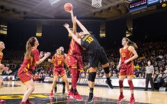 Iowa forward Megan Gustafson tries to block a shot during a women's basketball game against Iowa State University at Carver-Hawkeye Arena on Wednesday, Dec. 5, 2018. The Hawkeyes defeated the Cyclones 73-70.