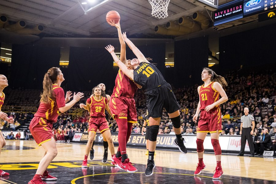Iowa+forward+Megan+Gustafson+tries+to+block+a+shot+during+a+women%27s+basketball+game+against+Iowa+State+University+at+Carver-Hawkeye+Arena+on+Wednesday%2C+Dec.+5%2C+2018.+The+Hawkeyes+defeated+the+Cyclones+73-70.+