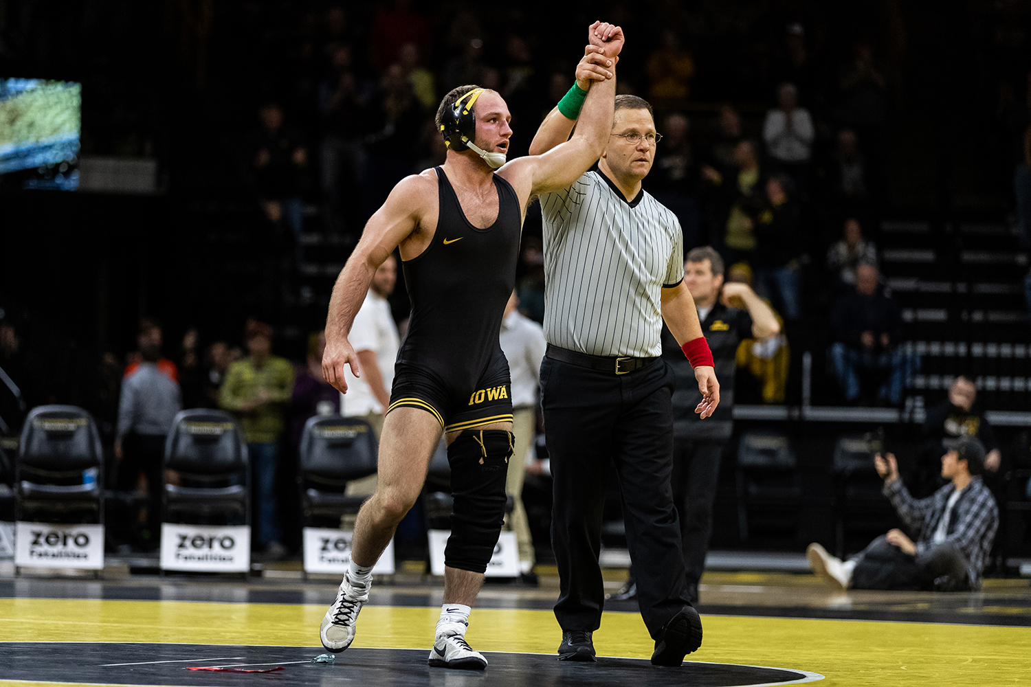 Iowa's No. 4 ranked Alex Marinelli celebrates defeating Princeton's Dale Tiongson in a 165-pound wrestling match at Carver-Hawkeye Arena on Friday, Nov. 16, 2018.