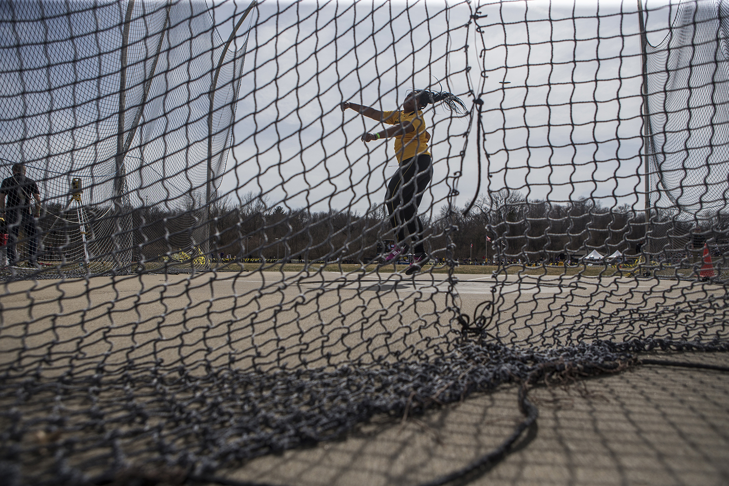 Iowa sophomore Laulauga Tausaga attempts a discus throw during the 19th annual Musco Twilight meet at the Francis X. Cretzmeyer Track in Iowa City on Thursday, April 12. Tausaga finished first in the event with a distance of 56.69 meters.
