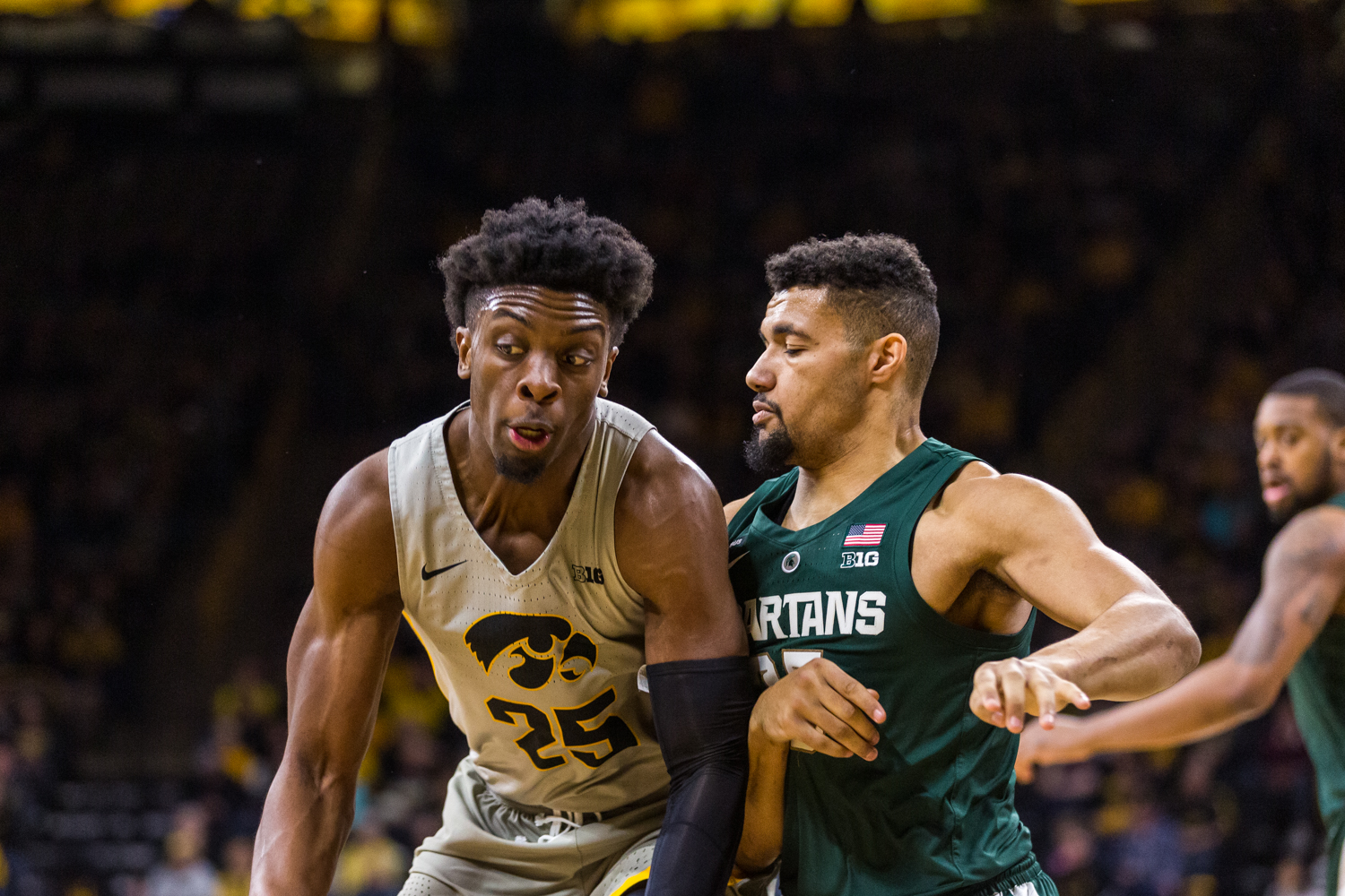 Iowa forward Tyler Cook #25 and Michigan State forward Kenny Goins #25 fight for the ball during a basketball game against Michigan State on Thursday, Jan. 24, 2019. The Spartans defeated the Hawkeyes 82-67.