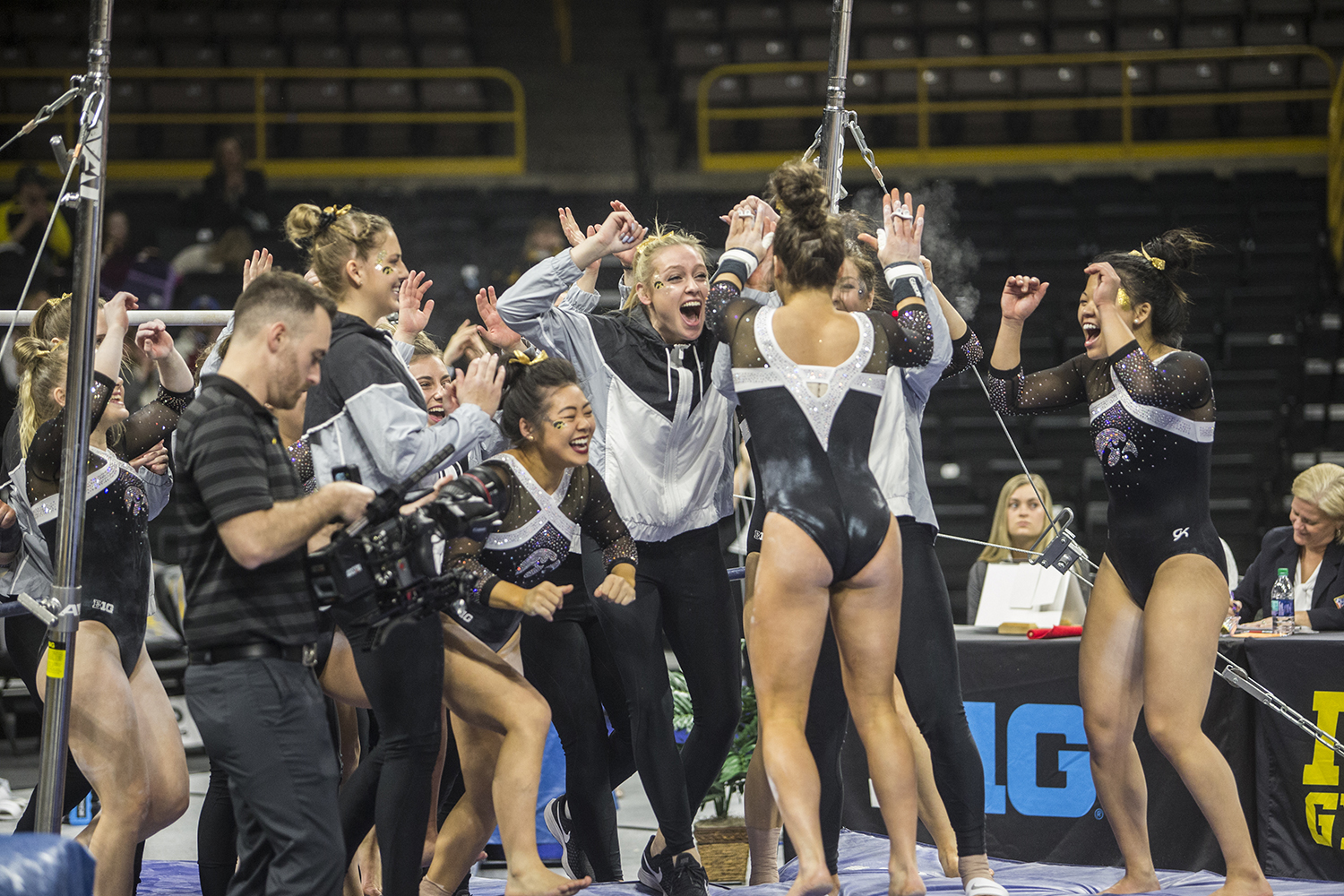 The+Iowa+women%27s+gymnastics+team+celebrates+together+during+a+meet+against+Rutgers+on+Saturday%2C+January+26%2C+2019.+The+Hawkeyes+defeated+the+Scarlet+Knights+194.575+to+191.675.+