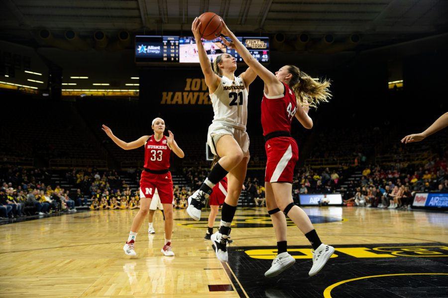 Iowa forward Hannah Stewart #21 rebounds a ball late in the fourth quarter in a women's basketball game against the Nebraska Huskers at Carver-Hawkeye Arena on Thursaday January 3, 2018. The Hawkeyes beat the Huskers, 77-71.