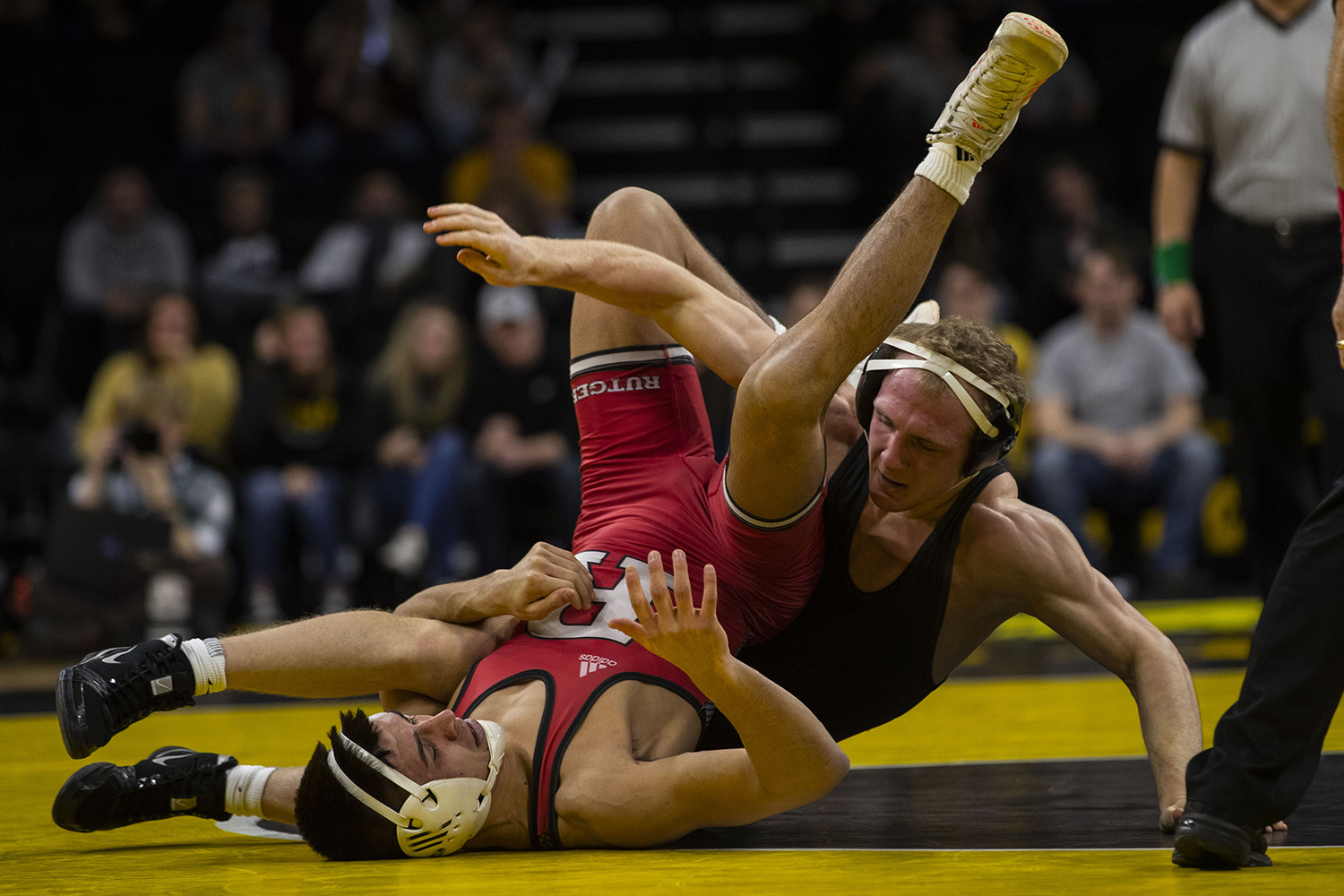 Iowa's #5 Kaleb Young wrestles Rutgers' #14 John Van Brill during the Iowa/Rutgers wrestling meet at Carver-Hawkeye Arena on Friday, January 18, 2019. Young defeated, 3-0. The Hawkeyes defeated the Scarlet Knights, 30-6. (Lily Smith/The Daily Iowan)