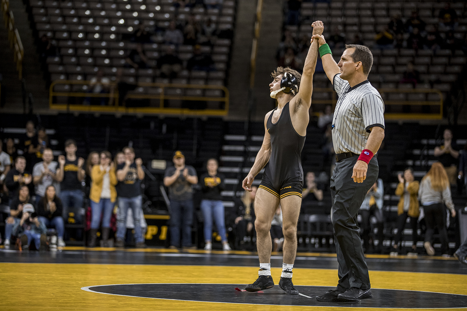 Iowa's Austin DeSanto reacts to his victory during Iowa's dual meet against Purdue at Carver-Hawkeye Arena in Iowa City on Saturday, November 24, 2018. DeSanto defeated Thornton 5-2. The Hawkeyes defeated the Boilermakers 26-9.