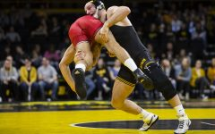 Hawkeye wrestling displays prominent stats, as record suggests