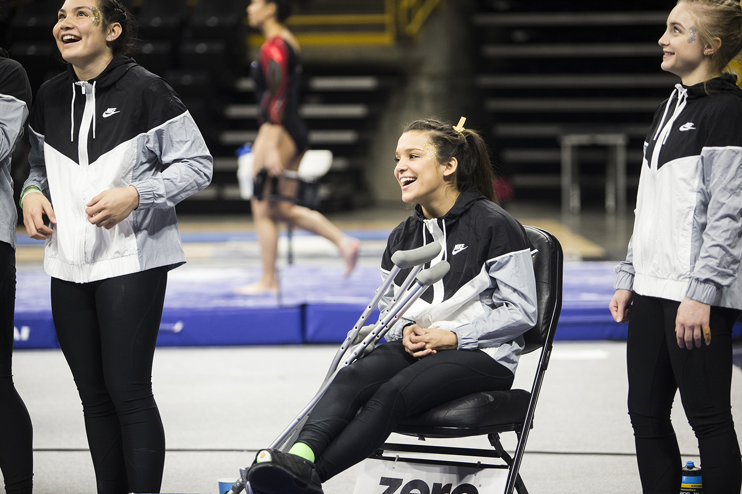 An+injured+Iowa+gymnast+cheers+on+her+teammates+at+a+meet+against+Rutgers+on+Saturday%2C+January+26%2C+2019.+The+Hawkeyes+defeated+the+Scarlet+Knights+194.575+to+191.675.+
