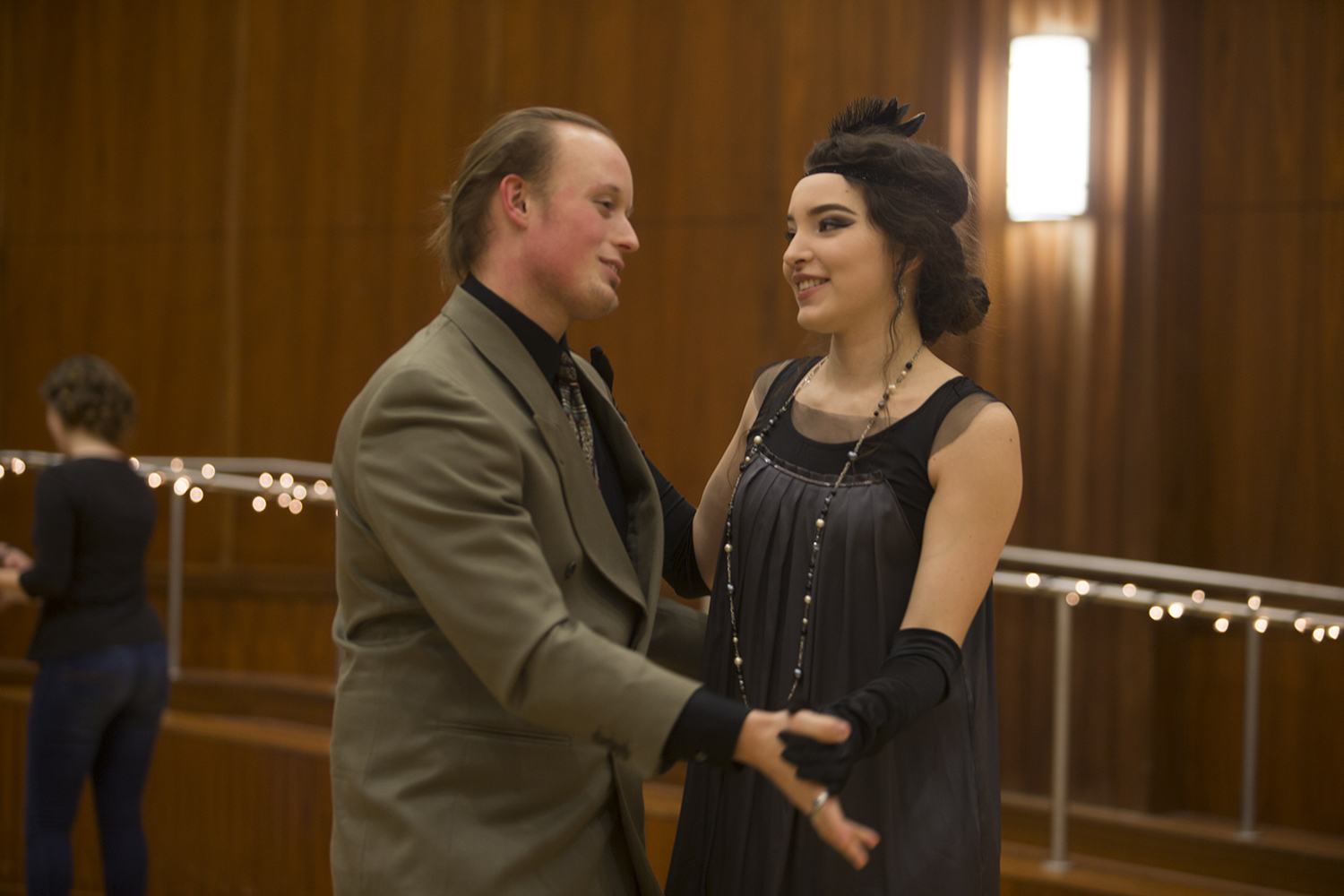 A couple dancing and dressed in 1920s style clothing at the Swing Dance Club's Gatsby Dance on Jan. 26 at the IMU.