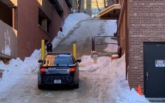 Police take down caution tape in the alleyway behind Halsey Hall on the UI campus, where Gerald Belz was found unresponsive early Wednesday morning.