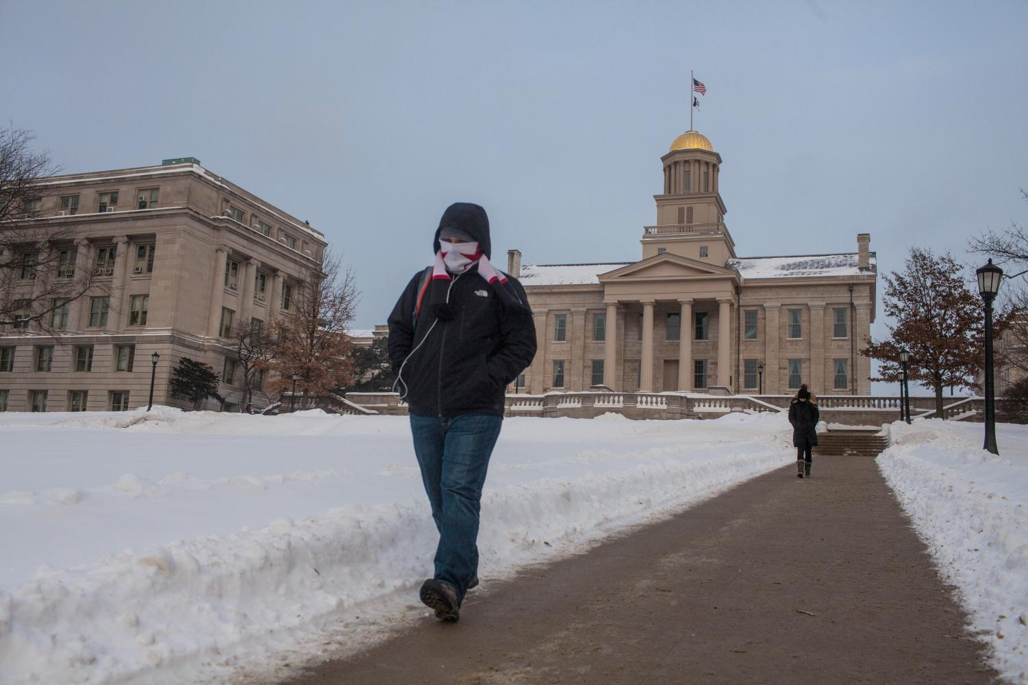 UI freshman Thomas Schutter walks in front of the Old Capitol on Monday.