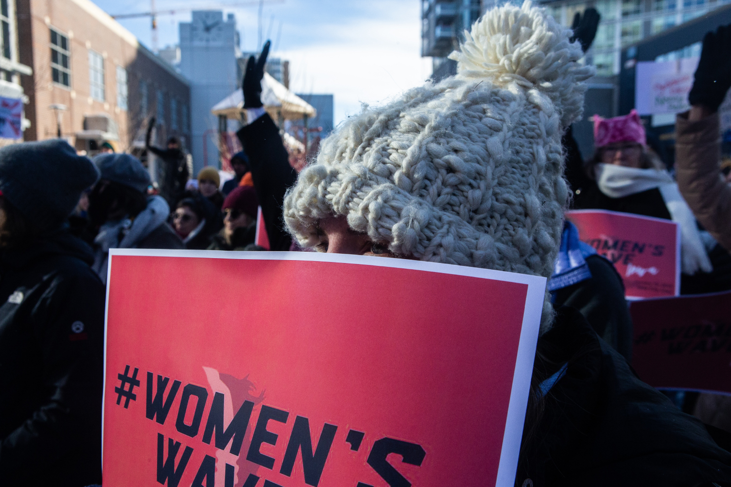 An attendee listens to a speech during the Women's March in Iowa City on Saturday, January 19, 2019. The Women's March is an annual event that started in 2017 following the inauguration of President Donald Trump. The march advocates for a range of issues including women's rights,  healthcare reform, LGBTQ+ rights, and environmental issues.