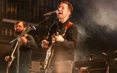 Lead vocalist and guitarist Taylor Goldsmith of Dawes sings during