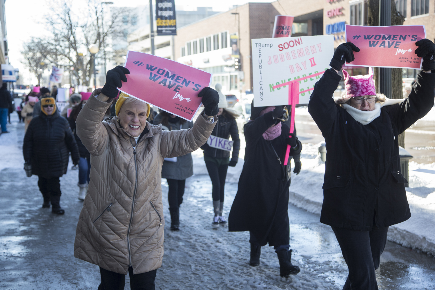 Attendees march on the pedestrian mall for the annual Women's March in Iowa City on Saturday, January 19, 2019. The Women's March is an annual event that started in 2017 following the inauguration of President Donald Trump. The march advocates for a range of issues including women's rights,  healthcare reform, LGBTQ+ rights, and environmental issues.