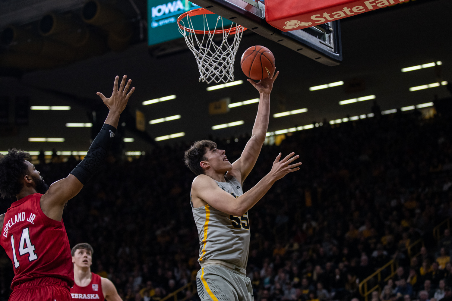 Iowa forward Luka Garza lays the ball up during Iowa's game against Nebraska at Carver-Hawkeye Arena on Sunday, January 6, 2019. The Hawkeyes defeated the Cornhuskers 93-84.