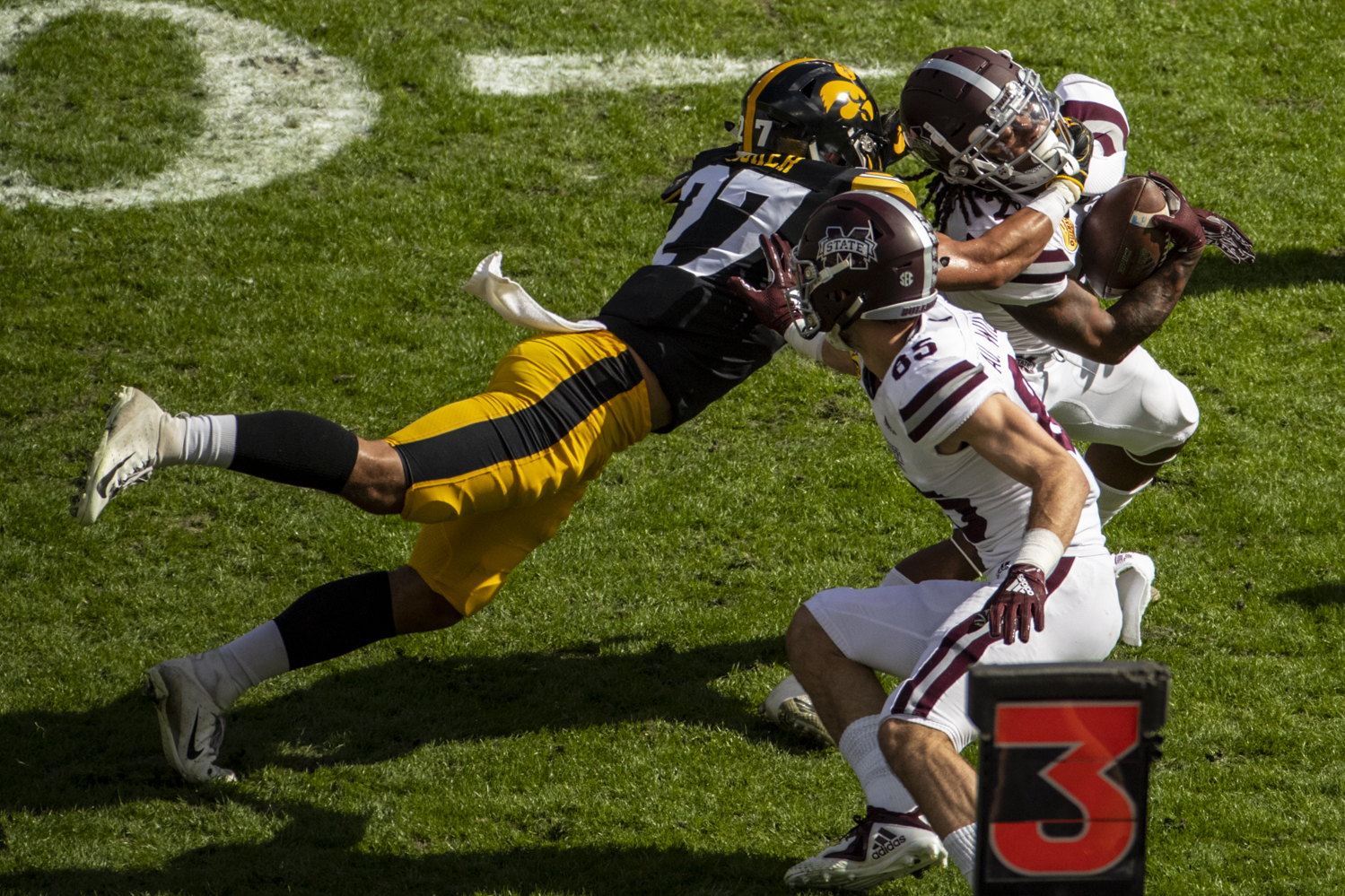 Iowa defensive back Amani Hooker tackles Mississippi State running back Aeris Williams during the Outback Bowl game between Iowa and Mississippi State at Raymond James Stadium in Tampa, Florida on Tuesday, Jan. 1, 2019. The Hawkeyes defeated the Bulldogs, 27-22.