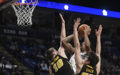 Joe Wieskamp and Luka Garza block a shot by Penn State's Lamar Stevens. The Hawkeyes defeated the Nittany Lions, 89-82.