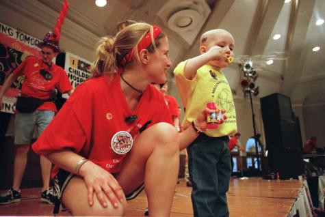 Dance Marathon morale captain Emily Retzel lends her bubbles to Christopher McIntosh at Dance Marathon on Feb. 5, 2000.