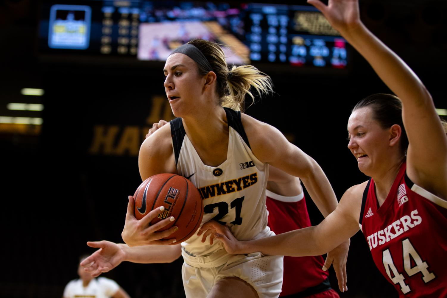 Iowa forward Hannah Stewart #21 rebounds a ball late in the fourth quarter in a women's basketball game against the Nebraska Huskers at Carver-Hawkeye Arena on Thursaday January 3, 2018. The Hawkeyes beat the Huskers, 77-71. (Roman Slabach/The Daily Iowan)
