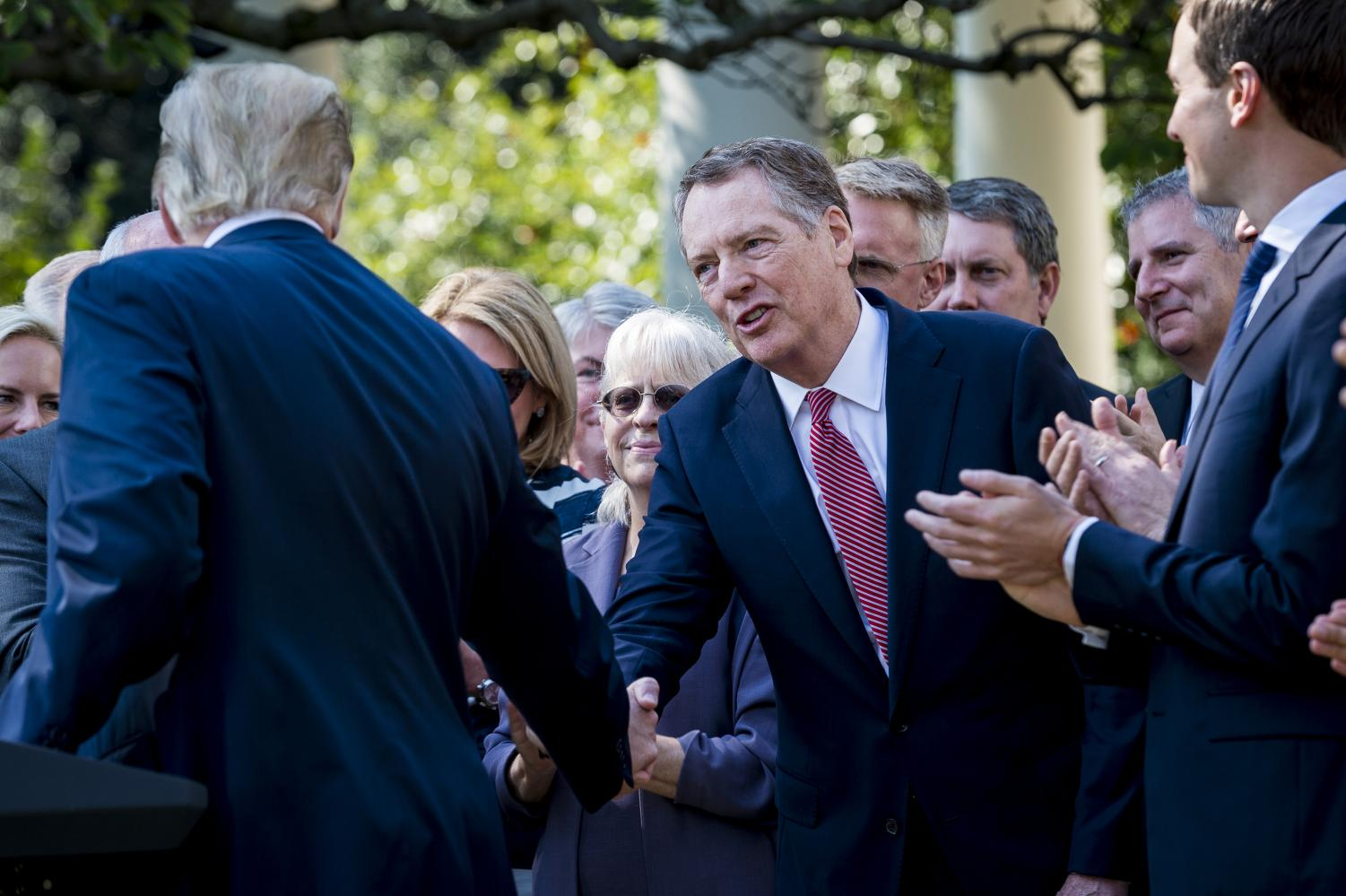 President Donald J. Trump congratulates U.S. Trade Representative Robert Lighthizer as he delivers remarks on the United States Mexico Canada Agreement (USMCA) in the Rose Garden at the White House on Monday, Oct. 1, 2018 in Washington, D.C. President Trump announced the United States and Canada have agreed to a deal replacing the North American Free Trade Agreement. (Pete Marovich/Abaca Press/TNS)