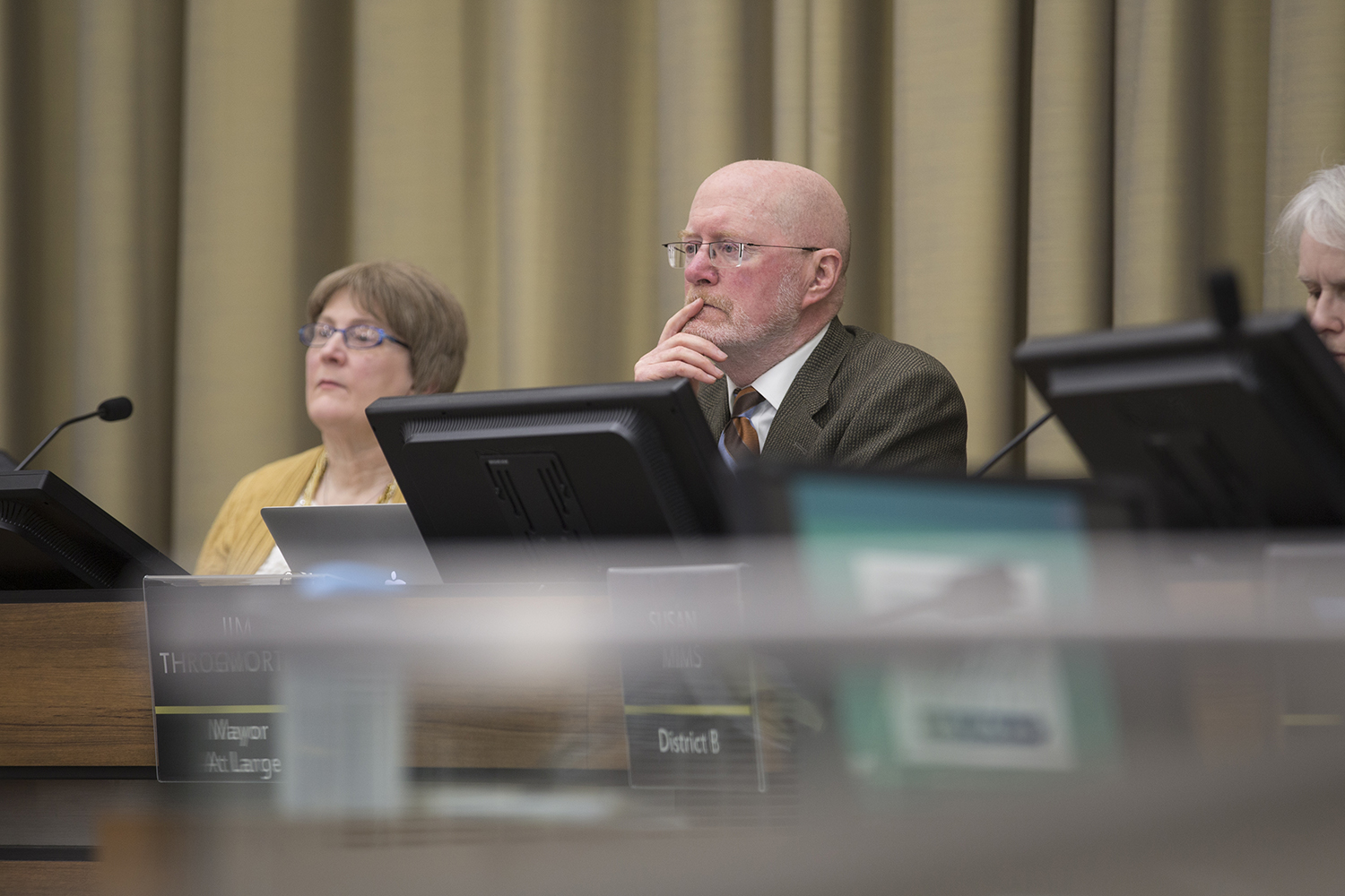 Iowa City Mayor Jim Throgmorton listens as community members address complaints regarding the new benches for the Pedestrian Mall at City Hall in Iowa City on Tuesday, January 22, 2019. Some community members feel that the new benches are hostile to the homeless.